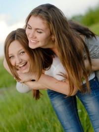 teen-girls-hugging-outside